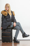 Happy young woman in warm jacket with suitcase. Gorgeous blonde tourist travel girl. Tourism Royalty Free Stock Photos