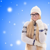 Happy young woman in warm winter clothes over christmas backgrou Stock Photography