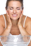 Happy young woman washes face Royalty Free Stock Images