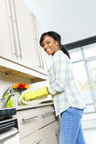 Happy young woman washing dishes Royalty Free Stock Photography