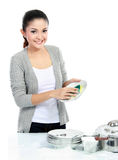 Smiling woman washing dishes Royalty Free Stock Image