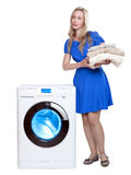 The happy young woman and washing machine Royalty Free Stock Photography