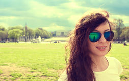 Happy young woman in Washington DC downtown on a spring summer sunny day. Closeup portrait of a happy young woman in Washington DC downtown on a spring summer Royalty Free Stock Image