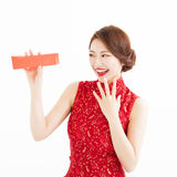 Happy young woman watch the  red envelope Royalty Free Stock Images