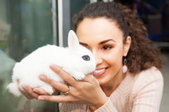 Happy young woman watching Hotot rabbit Royalty Free Stock Photos