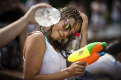 Happy young woman with water gun Royalty Free Stock Image