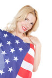 Happy young woman wearing american flag Royalty Free Stock Photos