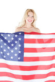 Happy young woman wearing american flag Stock Photography