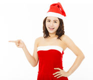 Happy young woman wearing christmas suit with santa cap Royalty Free Stock Image