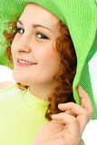 Happy young woman wearing a green hat royalty free stock images