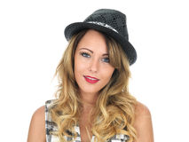 Happy Young Woman Wearing a Hat Royalty Free Stock Photography