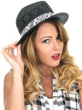 Happy Young Woman Wearing a Hat Stock Photos