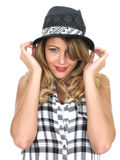 Happy Young Woman Wearing a Hat Stock Photo
