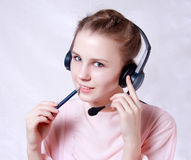 Happy young  woman wearing headset Stock Image