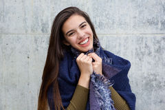 Happy young woman wearing scarf. Portrait of happy young woman wearing scarf Royalty Free Stock Image