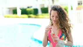 Young woman wearing swimsuit and blowing bubble wand stock video