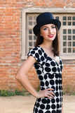 Happy young woman wearing top hat Stock Photography