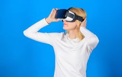 Happy young woman wearing virtual reality goggles watching movies or playing video games. Excited smiling businesswoman. Wearing virtual reality glasses. Woman stock photo