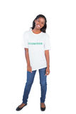 Happy young woman wearing volunteer tshirt