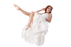 Happy young woman in a wedding dress Stock Photography