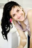 Happy young woman with wet hair smiling looking camera Royalty Free Stock Photos