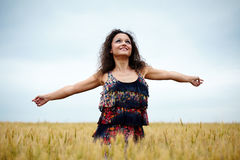 Happy young woman in wheat field Stock Photos