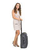 Happy young woman with wheels suitcase Stock Image