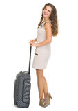 Happy young woman with wheels suitcase Royalty Free Stock Photography
