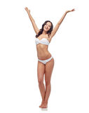 Happy young woman in white bikini swimsuit dancing Royalty Free Stock Photos