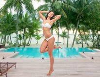 Happy young woman in white bikini swimsuit Stock Photo