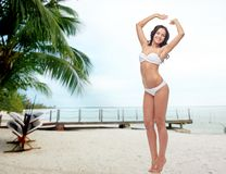 Happy young woman in white bikini swimsuit Royalty Free Stock Photography