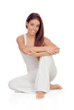 Happy young woman with white comfortable clothing sitting on the Stock Image