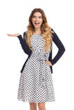 Happy Young Woman In White Dotted Dress And Cardigan Is Presenting Royalty Free Stock Photos