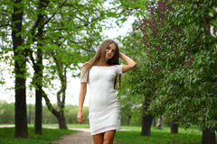 Happy young woman in white dress against the background spring Royalty Free Stock Photos