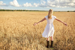 Happy young woman in white dress on cereal field Royalty Free Stock Photos