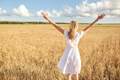 Happy young woman in white dress on cereal field Stock Images