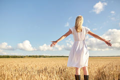 Happy young woman in white dress on cereal field Royalty Free Stock Image