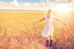 Happy young woman in white dress on cereal field Royalty Free Stock Photo
