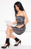 Happy young woman with white netbook Stock Images