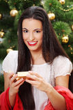 Happy young woman whith box gift on christmas. Royalty Free Stock Photo