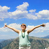 Happy young woman with wide open arms Stock Images
