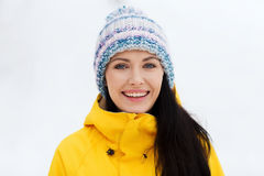 Happy young woman in winter clothes outdoors Royalty Free Stock Photography