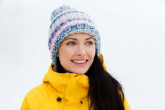 Happy young woman in winter clothes outdoors Royalty Free Stock Images