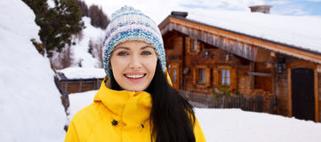 Happy young woman in winter clothes outdoors Stock Photo