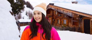 Happy young woman in winter clothes outdoors Stock Photos