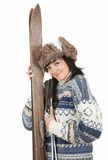 Happy young woman holding old wooden skis Royalty Free Stock Photo