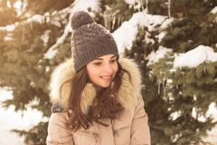 Young woman in winter park. Happy young woman in winter park enjoy her life Royalty Free Stock Image
