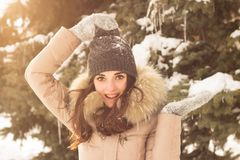 Young woman in winter park. Happy young woman in winter park enjoy her life Stock Image