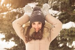 Young woman in winter park. Happy young woman in winter park enjoy her life Stock Photo