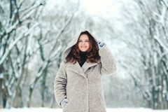 Happy young woman in wintertime, walk in nature. Stock Photos